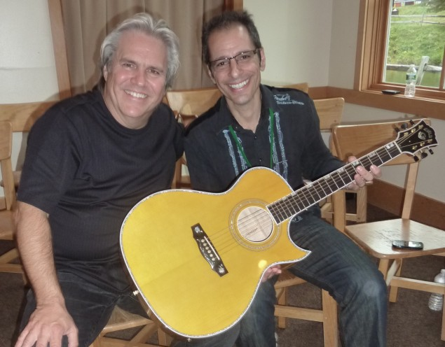 Street Sounds Proprietor, Rocky Schiano (right), with Doyle and his Signature Model Guild Acoustic